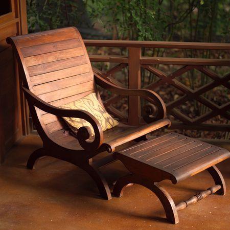 wooden railings: Malpais in Costa Rica,Empty wooden lounge chair