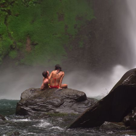 cascade: Costa Rica,Man and Woman by Waterfall Stock Photo