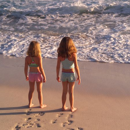 vacationing: Vacationing in Costa Rica,Girls standing on a beach in Costa Rica