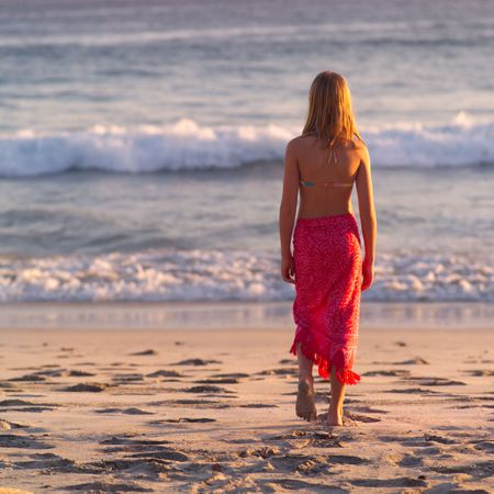Vacationing in Costa Rica,Girl in a sarong walking on the beach