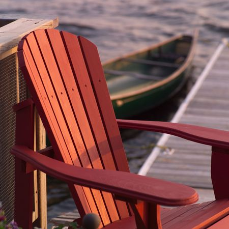 wooden dock: Lake of the Woods Ontario Canada,Empty chair Stock Photo