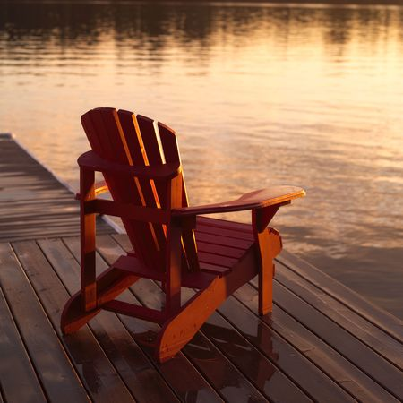 deck chair: Lake of the Woods Ontario Canada,Empty chair on dock