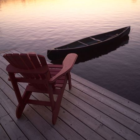 canoes: Lake of the Woods Ontario Canada,Empty chair and canoe Stock Photo