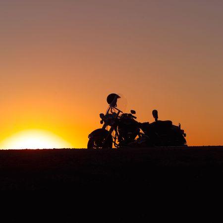 sunrises: Canadian Prairies,Silhouette of motorcycle