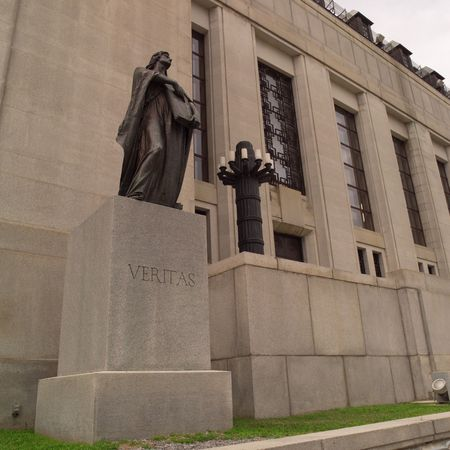 ade: Ottawa Ontario Canada,Veritas statue in front of Supreme Court of Canada building Stock Photo