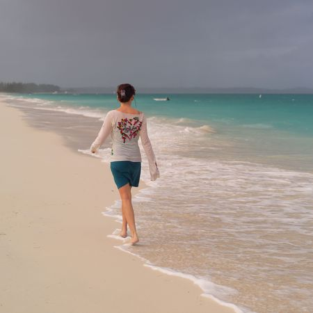 calming: Parrot Cay,Woman walking on Parrot Cay beach