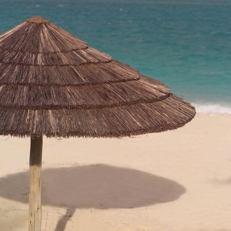 cay: Parrot Cay,Grass umbrella on Beach at Parrot Cay