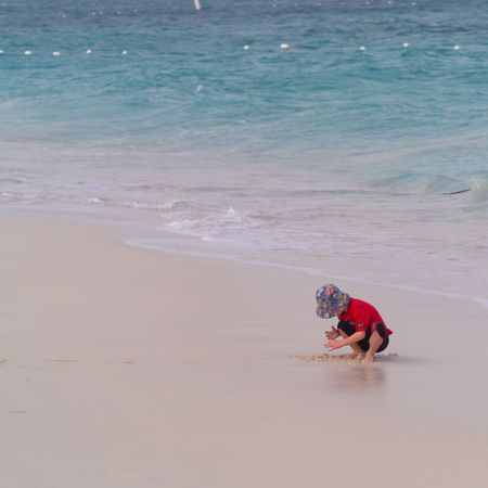 cay: Parrot Cay,Child on the Beach at Parrot Cay Stock Photo