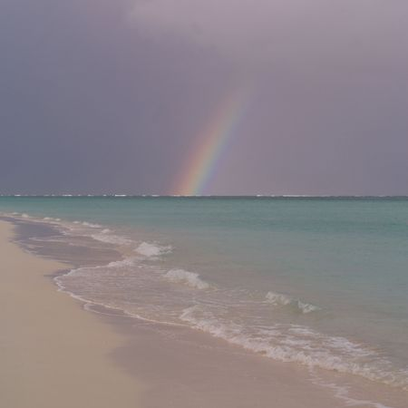 cay: Parrot Cay,Rainbow over ocean at Parrot Cay
