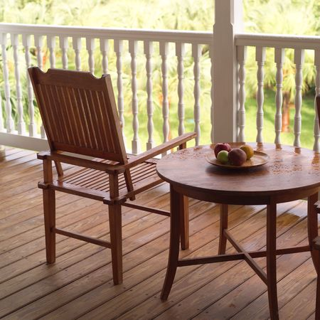 cay: Parrot Cay,Empty chair on a porch