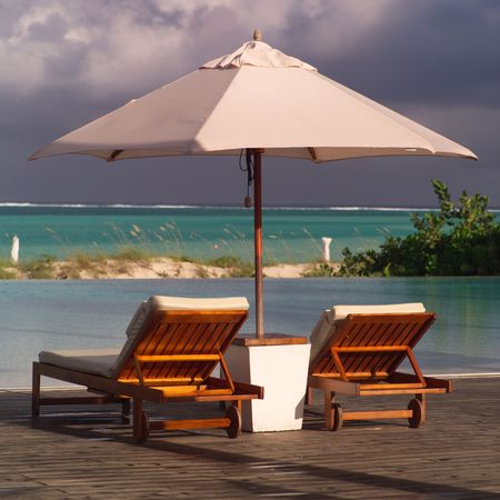Parrot Cay,Chaise lounge chairs Reklamní fotografie