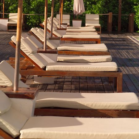 cay: Parrot Cay,Chaise lounge chairs Stock Photo