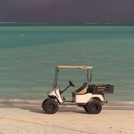 cay: Parrot Cay,Golf cart on Parrot Cay beach