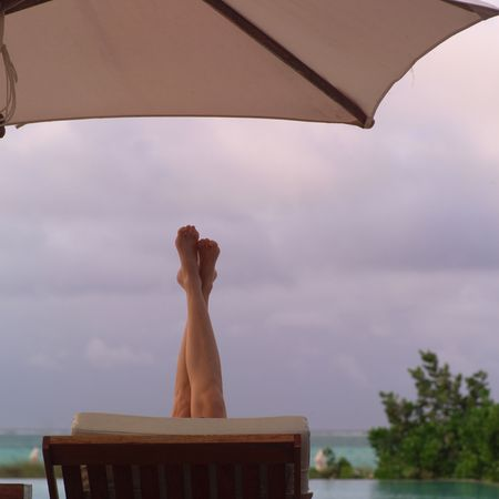 lounge: Parrot Cay,Legs stretching in the air Stock Photo