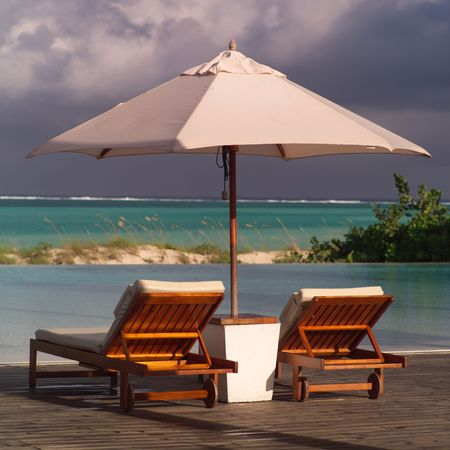 chaise lounge: Parrot Cay,Chaise lounge chairs Stock Photo
