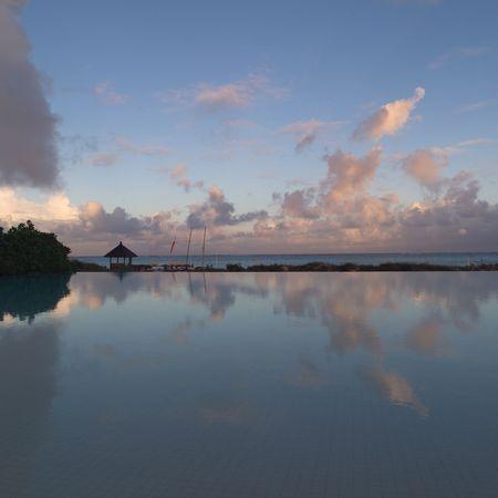 cay: Parrot Cay,Parrot Cay beach at dusk Stock Photo