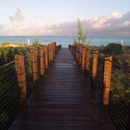 cay: Parrot Cay,Boardwalk at Parrot Cay Stock Photo