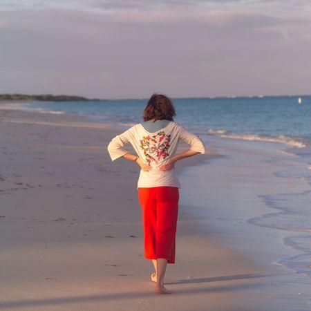 cay: Parrot Cay,Tourist walking on beach Stock Photo