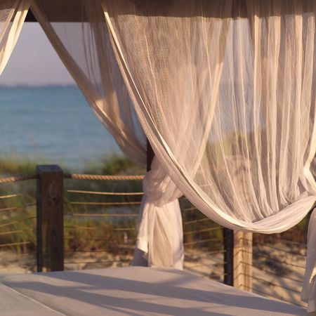 cay: Parrot Cay,Curtains on a beach hut