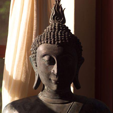 cay: Parrot Cay,Buddha Stone Sculpture Stock Photo