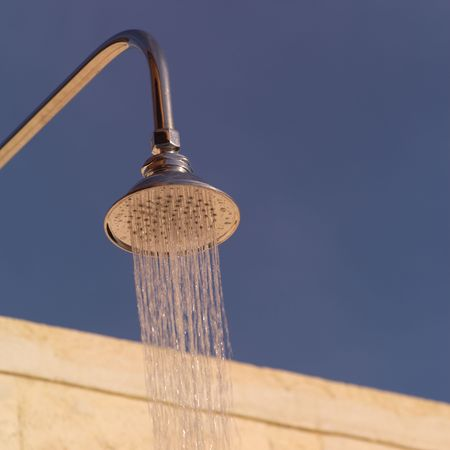 cay: Parrot Cay,Shower head spraying water in Parrot Cay Stock Photo