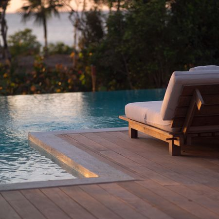cay: Parrot Cay,Lounge chairs at poolside Stock Photo