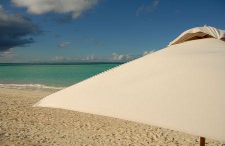 cay: Parrot Cay,Umbrella on the Parrot Cay beach