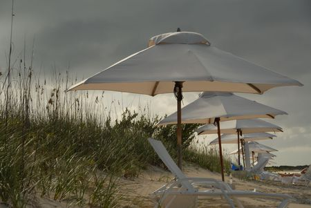 cay: Parrot Cay,Umbrellas on the Parrot Cay beach Stock Photo