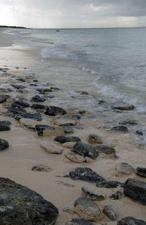 cay: Parrot Cay,Rocks on Parrot Cay beach
