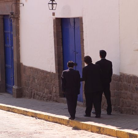 cusco: Cusco Peru, Men walking down street