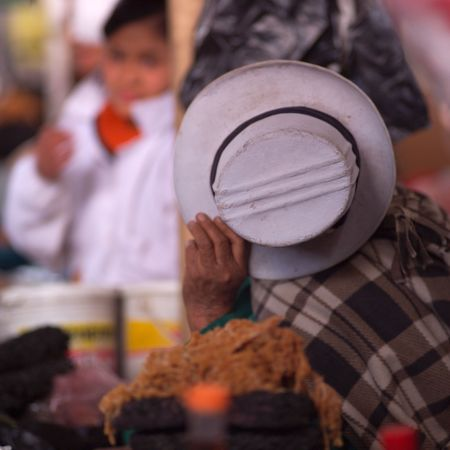 Cusco Market Peru, Person hiding their face with a hat