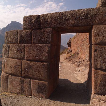 Ruins of Pisaq - Temple of the Sun in Peru, Ancient stone wall Фото со стока