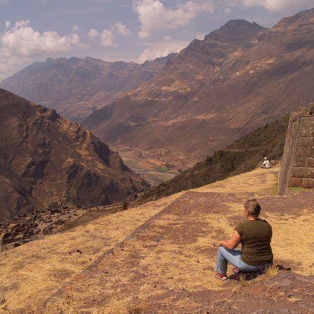 pisaq: Ruins of Pisaq - Temple of the Sun in Peru, Tourist in Pisaq Stock Photo
