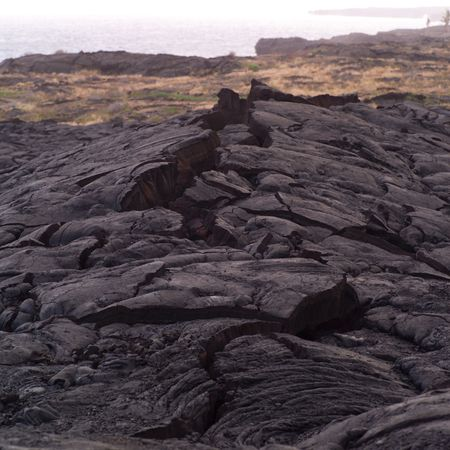 Cracks in the hardened lava of Hawaii Volcanoes National Park Stock Photo