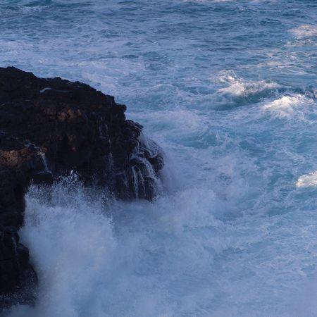 waves crashing: Waves crashing on the shore of Hawaiis Big Island. Stock Photo