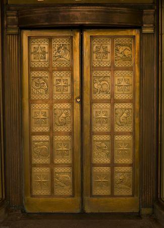 Carved door on building in Montreal