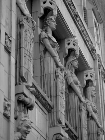 ade: Carved Statues on Fa�ade of Building in Montreal Stock Photo