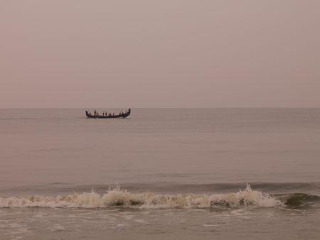Boat on the Arabian Sea, Kerala, India photo