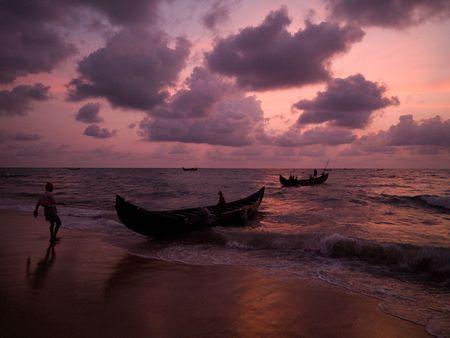 Fishing boat on the beach of the Arabian Sea, Kerala, India photo