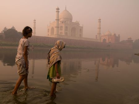 levit: Two girls with the Taj Mahal in the background
