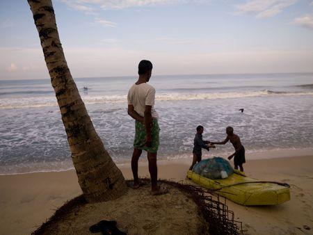 People on the beach of the Arabian Sea photo