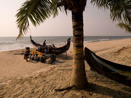 Fisherman on the beach of Arabian Sea photo