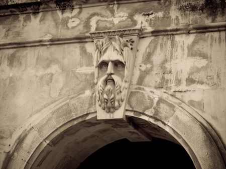 Engraved face on building in Mumbai India