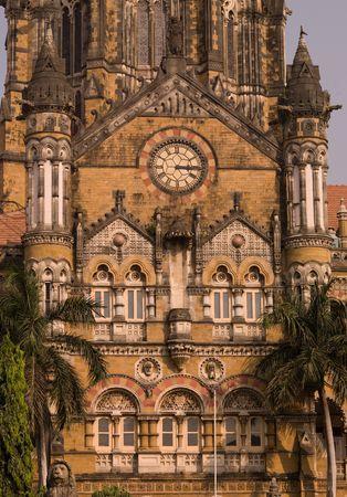 Clock on exteror of building in Mumbai Stock Photo