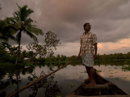india fisherman: Fisherman on his boat in India Stock Photo