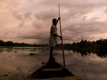 Fisherman on his boat in India photo