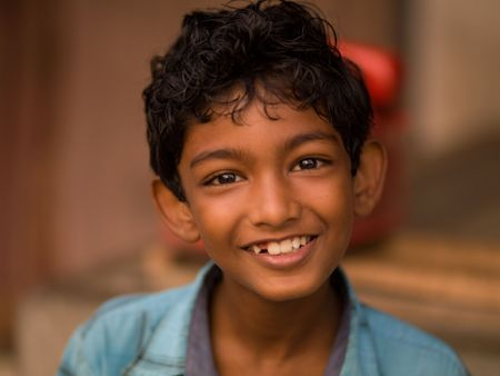 Close up of a young smiling boy in India 写真素材