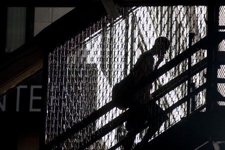 Silhouette of a person walking up on staircase in Chicago photo