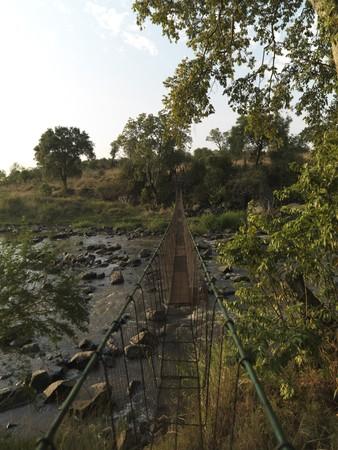 Suspension bridge and stream Kenya Africa