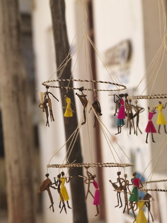 puppets: Suspended puppets on display in Lamu Town, Kenya Africa